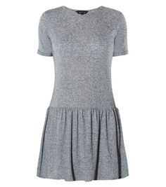 Drop hem dresses are the new style of the season, ideal for updating classic daytime looks. Just add chelsea boots to finish. #nlfashion #dresses #dropwaist #grey #dress