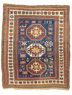 A Kazak rug, Southwest Caucasus -   dated 1251 in Arabic numerals (1835-1836 AD) and 1837 in Roman numerals, approximately 168 by 137cm; 5ft. 6in., 4ft. 6in., dated 1837