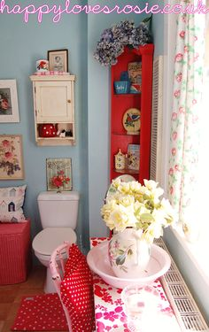 HAPPY LOVES ROSIE; duck egg blue bathroom with red, roses, white, and polka-dots