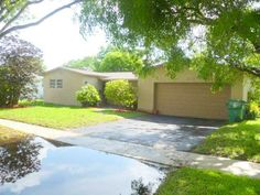 Cooper City, FL House or sale. 3 Bed/2 Baths. $324,900 -  Canal views from this 3/2 + family room pool home. domed screened pool/patio on oversized fenced lot. kitchen/baths updated approx 10 yrs ago, kitchen w/tiled counters, walk-in pantry. newer central a/c system & water heater (2009), solar heated pool and child safety fence for pool. Hurricane panels for all doors/windows.  Cooper City address & schools!