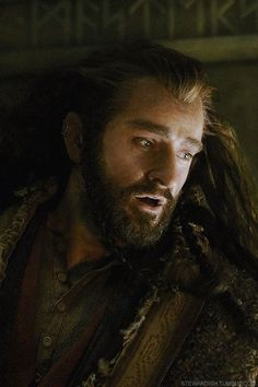 Thorin's Estatic Face looking at the treasure-hord.