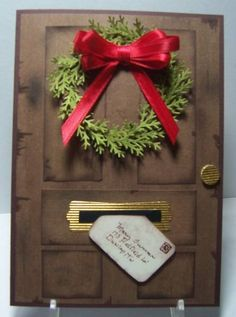 handmade Christmas card ... Door with Wreath and Letter ... panel door ... letter coming through the mail ... punched foliage ... multi-loop red bow ... great card!