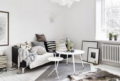 new scandi-inspired living room, with lots of relaxed neutral colours and cosy textures, with a little help from Nest.co.uk