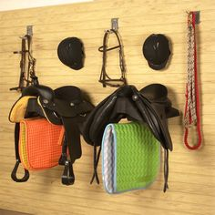 Save space with a saddle holder and your tack room will be neat and organized.