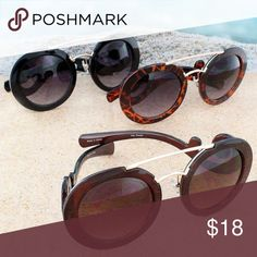 🆑Crossbar Sunglasses with Swirl Detail These stylish sunglasses are perfect for the beach, pool, or for everyday use! (Listing is for the pair in the middle)  Polycarbonate UV 400 Plastic Frames and Arms Swirl Design on Arms Metal Crossbar Horn Rimmed Design Round Lenses Accessories Sunglasses