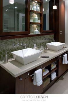 Glass Tile Backsplash • Vessel Sinks • Wood Cabinets • Cabinet Lighting in the Bathroom • Wall mount Faucets • Bathroom Storage • Quartz Countertops in the Bathroom • Bathroom Cabinet Design Ideas • #candiceolson #candiceolsondesign Bathroom Renos, Bathroom Renovations, Bathroom Faucets, Bathrooms, Sinks, Bathroom Wall, Bathroom Storage, Master Bathroom, Wooden Vanity