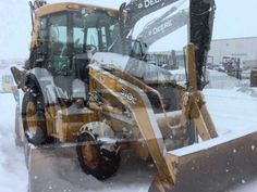 John Deere construction equipment in the snow