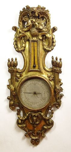18/19th Century French Carved Gilt Wood Barometer. Hand painted Dial and Gauge. Typical Wear, Cracks and Minor Losses Consistent with Age. Measures 43 Inches Length, 17 Inches Width