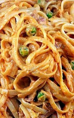 Creamy Tomato Alfredo Linguine with Peas and Prosciutto - My most requested sauce! Great with or without the peas and prosciutto!