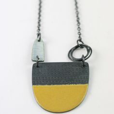 Tidal series neckpiece in mustard yellow | Contemporary Necklaces / Pendants by contemporary jewellery designer caroline finlay