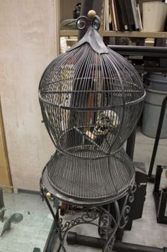 It probably already sold, but I had to share this vintage birdcage