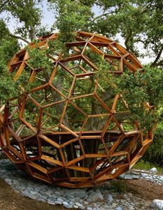 the Honey Sphere Tree House. Buckminster Fuller, who popularized geodesic domes, would love this tree house, owned by Robby Krieger, the guitarist of the Doors. (Tree Houses: Fairy Tale Castles in the Air) - [part of someone else's caption] Interior Tropical, Garden Art, Garden Design, Geodesic Dome Homes, Geodesic Sphere, Dome Structure, Cool Tree Houses, Cob Houses, Tree House Designs