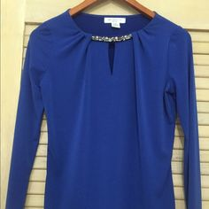 Classy Royal Blue Blouse with Crystal Detail Royal blue long sleeved blouse with crystal detail above keyhole opening.  Made of 94 percent polyester and 6 percent spandex.  Size PS. Only worn once. Liz Claiborne Tops Blouses