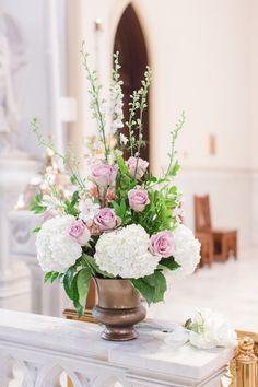 hydrangea and purple rose arrangement