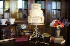 Piece of Cake: A cake gets wordy with book page decorations. You could also use book pages to make flags for cupcakes!  Photo by Josh McCullock via Ruffled