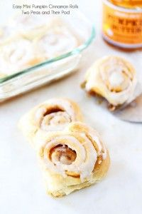 Easy Mini Pumpkin Cinnamon Rolls with Cream Cheese Frosting on twopeasandtheirpod.com Delicious cinnamon rolls that take less than 30 minutes to make!