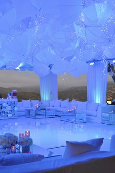 Now THAT'S a ceiling!  White umbrellas, blue-hue lighting and twinkle strings.