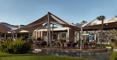 at a lagoon on turkey's southwestern coast, emre arolat architects has extended the region's existing marina complex with a series of additional facilities. Facade, Gazebo, Coast, Exterior, Outdoor Structures, Mansions, Architecture, House Styles, Building