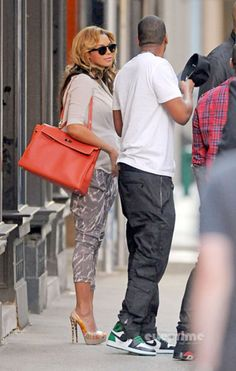 Jay-Z wearing Air Jordan 1 who cares-look at Bey's shoes!! OMG!
