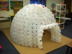 Igloos are cool. You can easily build an milk jug igloo in your classroom with some planning, lots of milk jugs and hot glue.