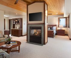 Sophisticated, contemporary double sided fireplace in the master bedroom. From 1 of 6 projects by Da Fireplace Seating, Small Fireplace, Bedroom Fireplace, Living Room With Fireplace, Fireplace Surrounds, Fireplace Design, Craftsman Fireplace, Cottage Fireplace, Fireplace Bookshelves