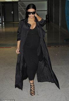 Bumping along: Now she's finally started to show, pregnant Kim proudly showed off her bab...