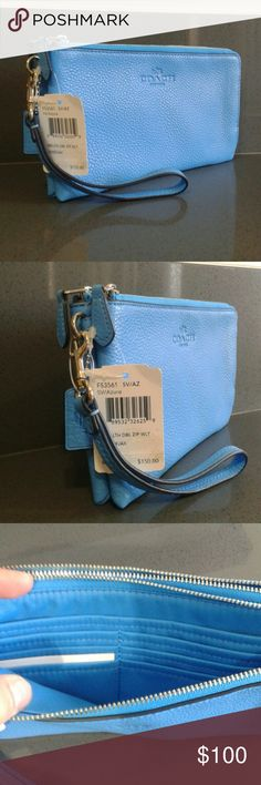 "Coach wristlet double zipper Coach wristlet is blue with silver logo and zippers. The strap is 6"" and detaches. Two pocket dividers on one side and card slot on the other, holds 8 cards. Made of pebbeled leather. NWT Coach color Azure Coach Bags Wallets"