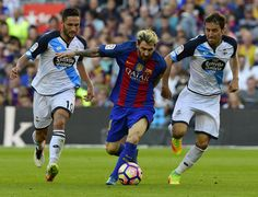 Barcelona's Argentinian forward Lionel Messi (C) vies with Deportivo's Romanian forward Florin Andone (L) and Deportivo's midfielder Pedro Mosquera Parada during the Spanish league football match FC Barcelona vs RC Deportivo de la Coruna at the Camp Nou stadium in Barcelona on October 15, 2016 / AFP / LLUIS GENE