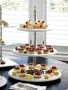 Take your parties to a new level with the Three-Tier Marble Etagere that elegantly displays your finest appetizers or treats.