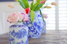 Using a variation of different sized vases to create dimension and height is a great way to style the table. Traditional blue and white vases can be versatile and mix with many styles. Sponsored by Happy by Design