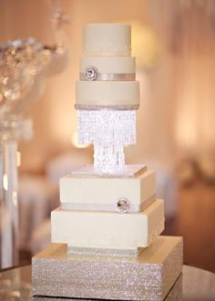 This glittering white cake is a masterpiece by Mishelle Handy Cakes. Table design by About Last Night...Event Planning. Photo by Kevin Paul Photography. #wedding #cake #white #sparkle #crystal