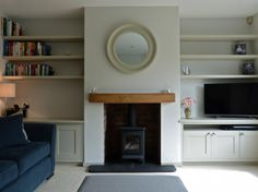 New Photographs Brick Fireplace before and after Popular Bespoke cabinetry painted Little Greene Slaked Lime Mid Log Burner Fireplace, Fireplace Shelves, Wood Burner, Brick Fireplace, 1930s Fireplace, Fireplace Ideas, Wood Furniture Living Room, Living Room Shelves, Living Room With Fireplace