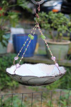 DIY ceramic bird bath. I think you could use this as a bird feeder too.