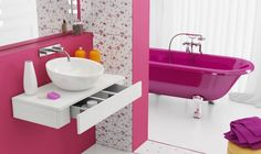 Bathroom Vanity Sink and Drawer in Counter to make the most of space.  Also look at that pink tub! o.o