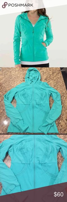 Lululemon Blue Dance Studio Yoga Zip Up Jacket Gorgeous Lululemon blue Dance Studio zip up jacket. Really soft interior with an other sized hood. The outside is water resistant with faint vertical stripes. Size 10 in mint condition. The sleeves are clean and come with thumb slits. It's also reversible, with a silver Lululemon emblem on the inside. lululemon athletica Jackets & Coats Utility Jackets