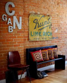 vintage letters & sign on a brick wall - makes me want a house with some exposed brick!
