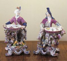 A PAIR OF BOW PORCELAIN SWEETMEAT FIGURES CIRCA 1765 Modelled as a Turk and Levantine Lady respectively, each seated on a mound holding a large shell, painted with flowers, the exterior with a puce rim above a shell-encrusted branch on scroll-molded bases enriched in puce and blue 8 3/8in. Sold for $ 9,560 u.s. oringallt these would cost a few shillings