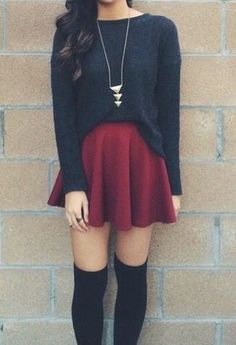 a black sweater with a long necklace and red skirt skater skirt are great…