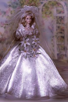 1995: Star Lily Bride Barbie Part of a special collection dedicated to wedding flowers, this Barbie's gown features floral detailing, and she carries a beautiful bouquet of lilies. Wedding Barbies - Vintage Barbies | Wedding Planning, Ideas Etiquette | Bridal Guide Magazine