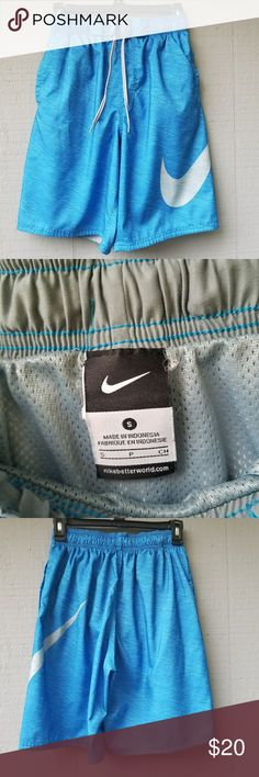 Nike Mens Bright Blue Swoosh Swim Trunks Small Bright blue marble/spacedye style print. Large white swoosh on the left thigh. Elastic waist with adjustable ties. Size small. Measurements coming soon! Nike Swim Swim Trunks
