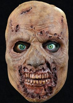 Officialy Licensed Walking Dead Rotted Walker Mask - Spend Fright Night looking like a Walker straight out of the post-apocalyptic setting of AMC's The Walking Dead. This officially licensed Rotted Walker Face Mask features a characteristic decaying nose, gaping flesh wounds across the forehead and a rotted jaw exposing the teeth and gums. This gruesome undead look will send even the most seasoned Walker Hunters running for the hills.  #walkingdead #yyc #costume #mask