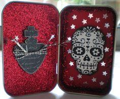 Dia de los Muertos (altered tin) by tammybeck.  Altoid tin? Nice skull illustration either way.