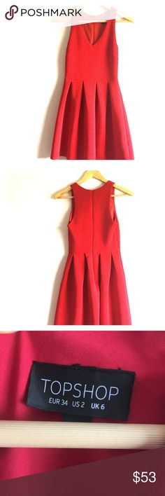 Topshop Red Baby Doll Dress Topshop Red Baby Doll Designer Style Alaia Dress Celebrity Style. Dress is in excellent condition and includes a zipper on the back that zips down 13 inches. Great for a casual day out on the town or to dress up for a date or an evening reception. Measurements: Pit to pit is 13 inches, height is 36.5 inches, and width is 12.5 inches.  Size 2 Material: 95% polyester and 5% elastane Lining is 65% polyester and 35% cotton. Machine wash separately.  Made in morocco…