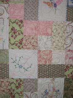 Close up of quilt using recycled vintage linens in the blocks.