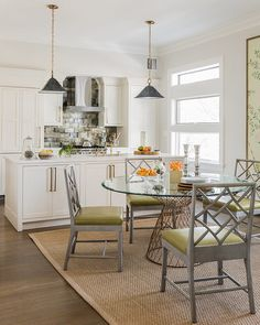 This table and chairs in this transitional dining area would be perfect for a light-filled sunroom because the pieces aren't heavy and won't obstruct the views   Lovejoy Designs