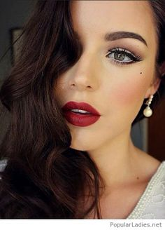 Green eyes, red lips and pearl earrings