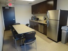 Employee break room with custom cabinetry and vct flooring
