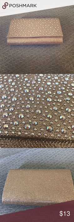 Champagne Clutch Perfect champagne clutch for prom or party. Has a chain on the inside that can be worn over the shoulder. Used once. David's Bridal Bags Clutches & Wristlets