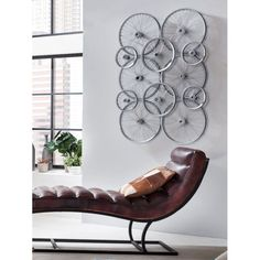 Fancy hanging bike wheels on the wall for retro decoration. Its a classic design thats sure to go down a storm with your fella as his main gift. From the Wall Art Company