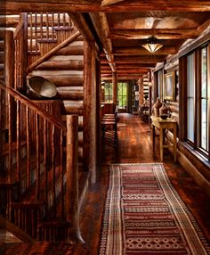 Incredible log home foyer and graduated stair case.  Check out the individual red willow twigs covering the stair risers!  Amazing detail!